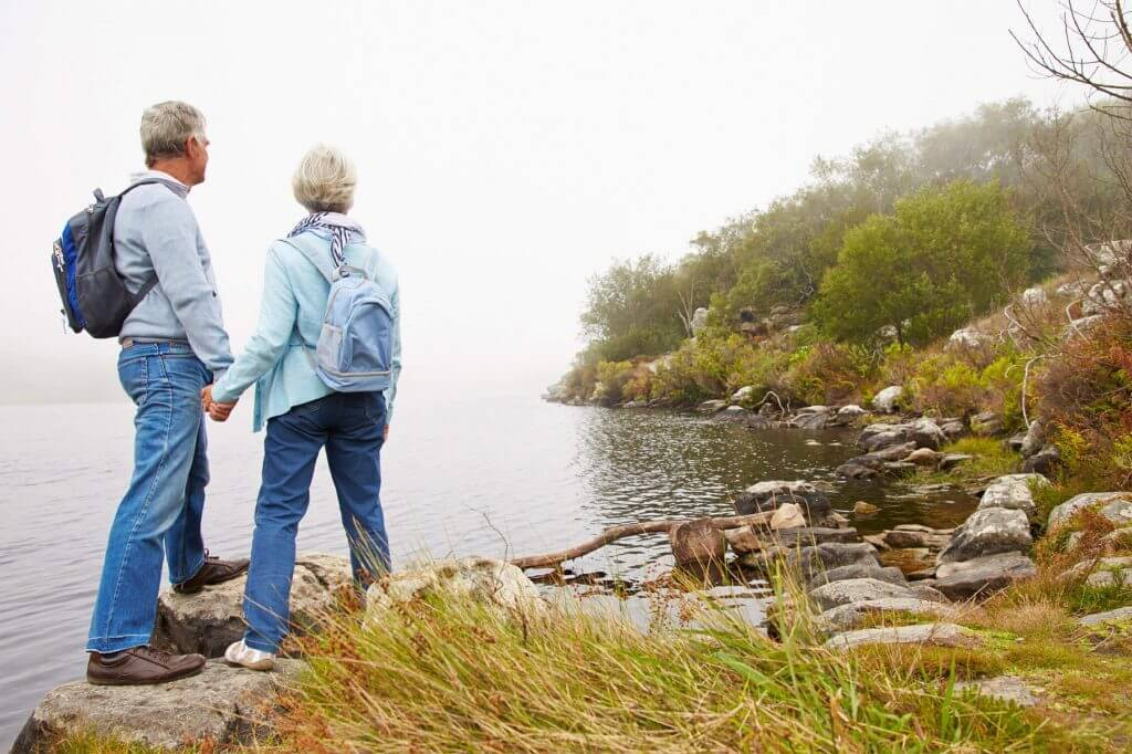 elderly couple at lake